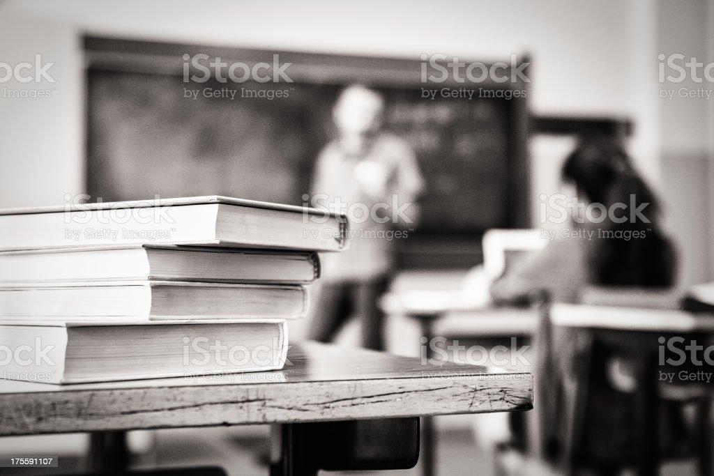 Books on desk stock photo