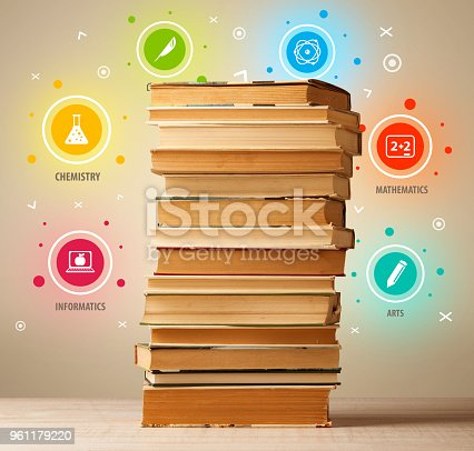 istock Books on top with colorful symbols on vintage background 961179220