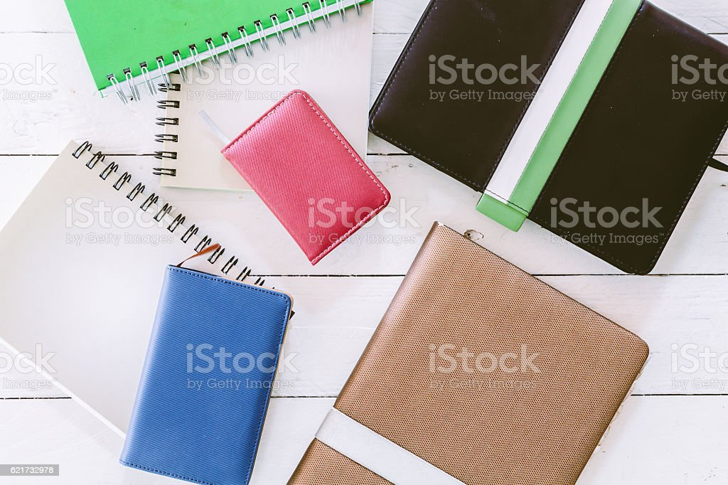 Books on wooden background stock photo