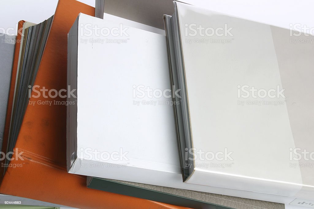 Books piled on top of each other stock photo