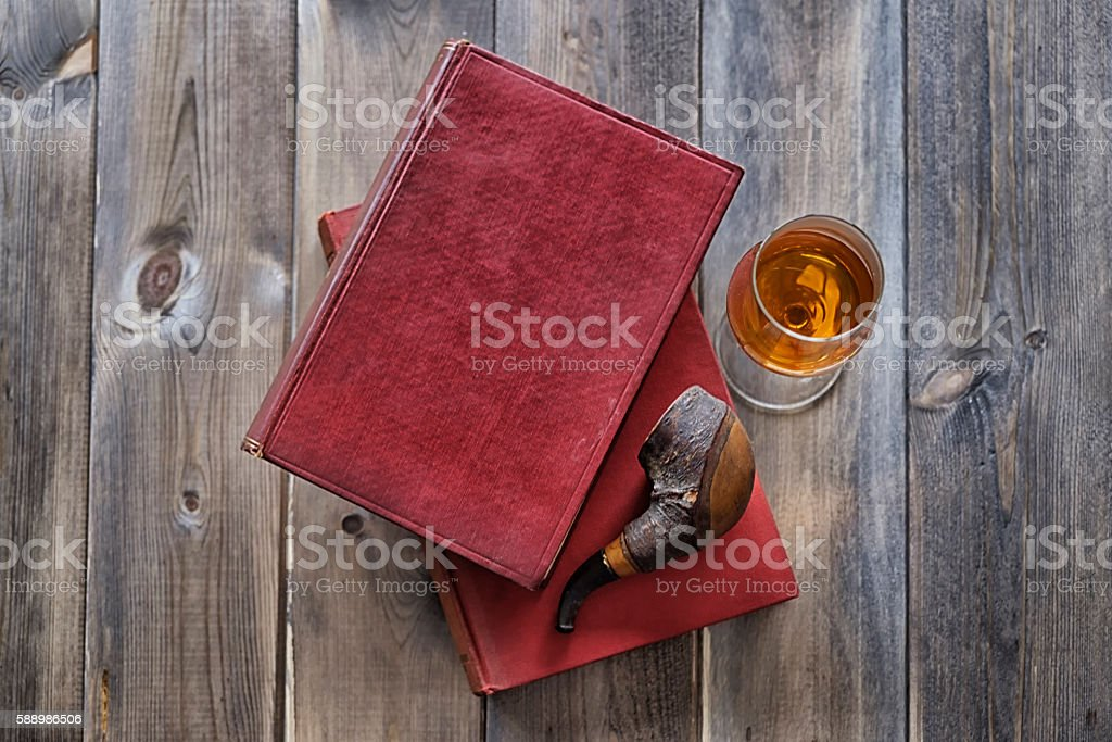 Books pipe and whisky stock photo