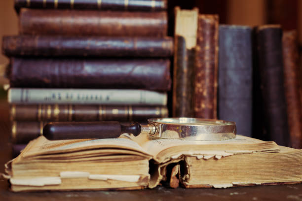 Books shelf with old open book. Books shelf with old open book. Old leather bound vintage books friar stock pictures, royalty-free photos & images