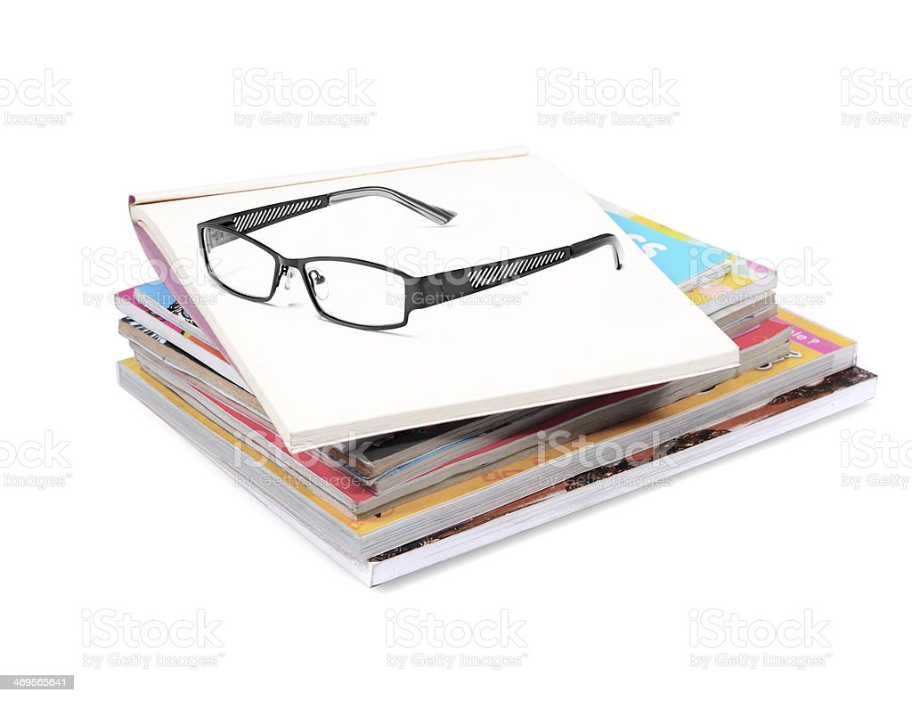 books stack with glasses  isolated on white background stock photo