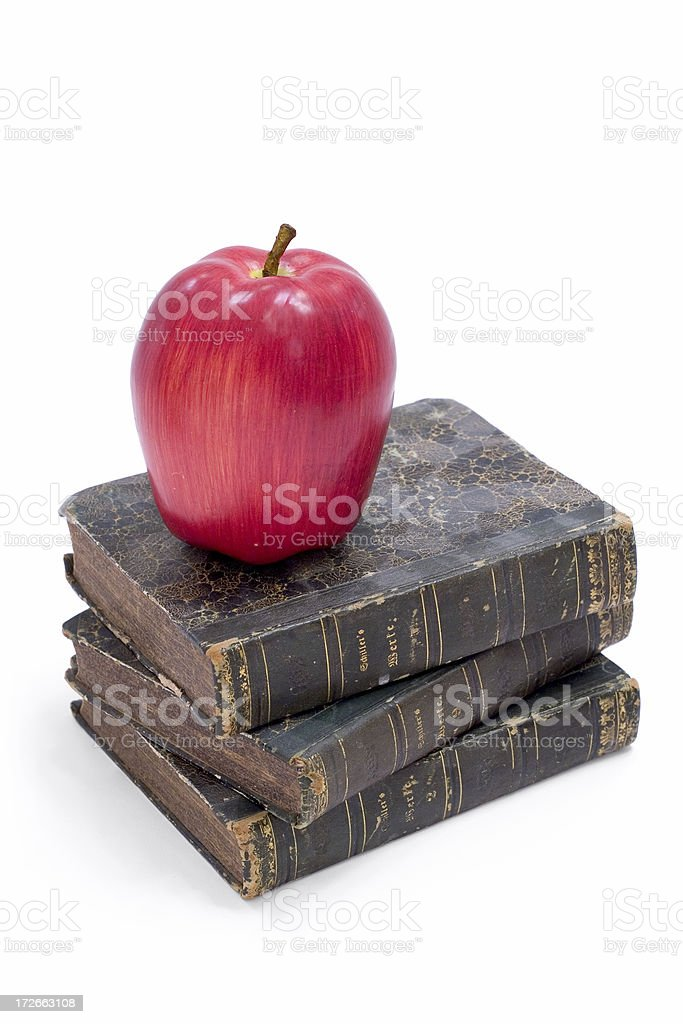 Books with Apple (staggered) royalty-free stock photo