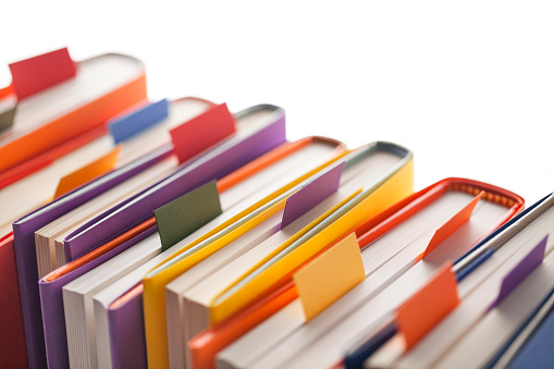 Books with bookmark on white background.