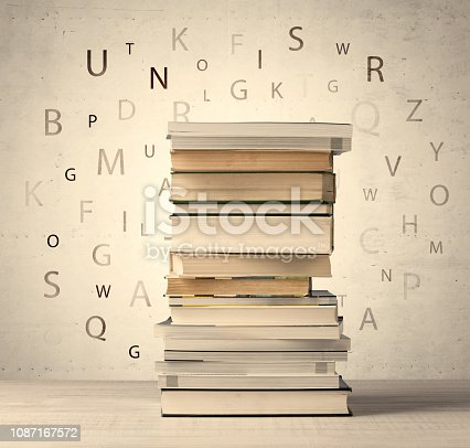 istock Books with flying letters on vintage background 1087167572