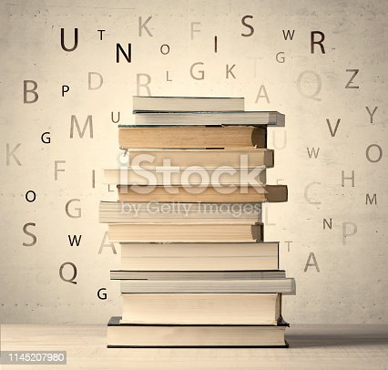 istock Books with flying letters on vintage background 1145207980