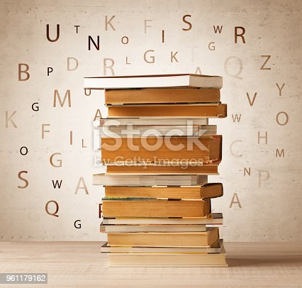 istock Books with flying letters on vintage background 961179162