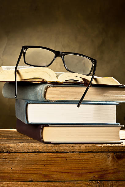 books with glasses stock photo