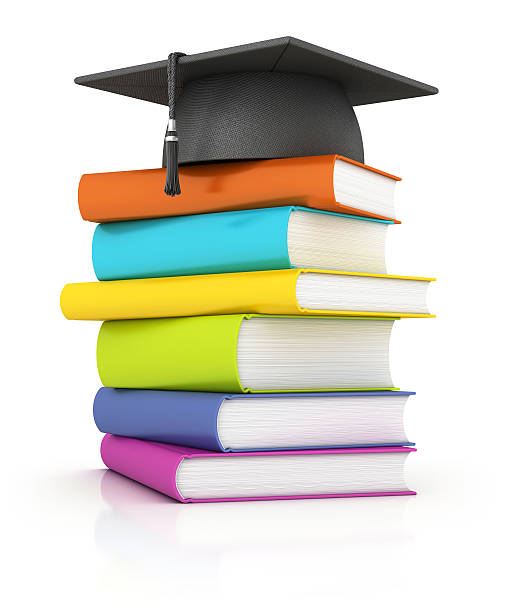 books with mortar board stock photo