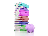 istock Books with Piggy Bank 625870614