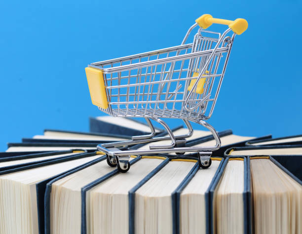 Books with trolley symbol of bookshop stock photo