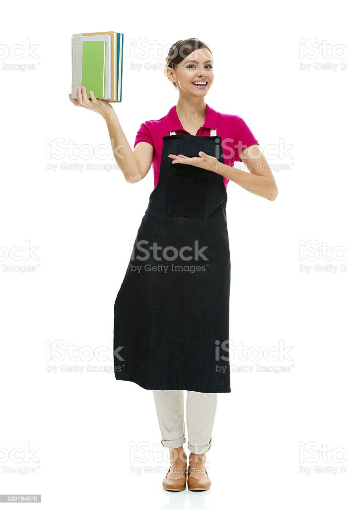 Bookseller showing books stock photo