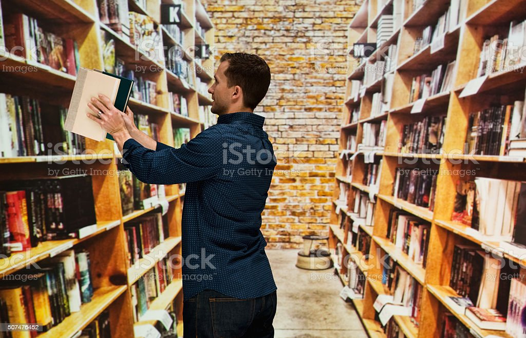 Bookseller working in library stock photo