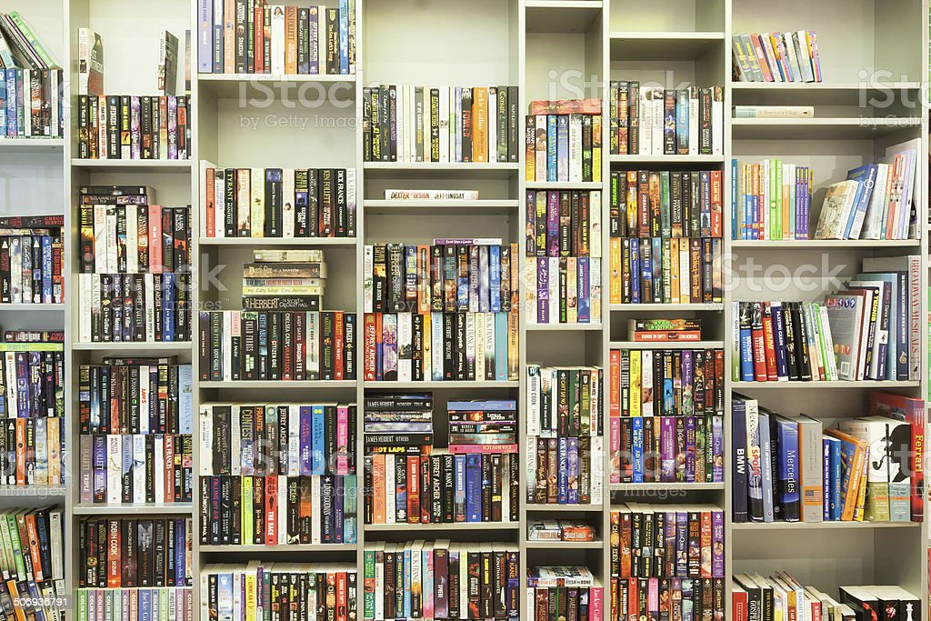 bookshelf in library stock photo