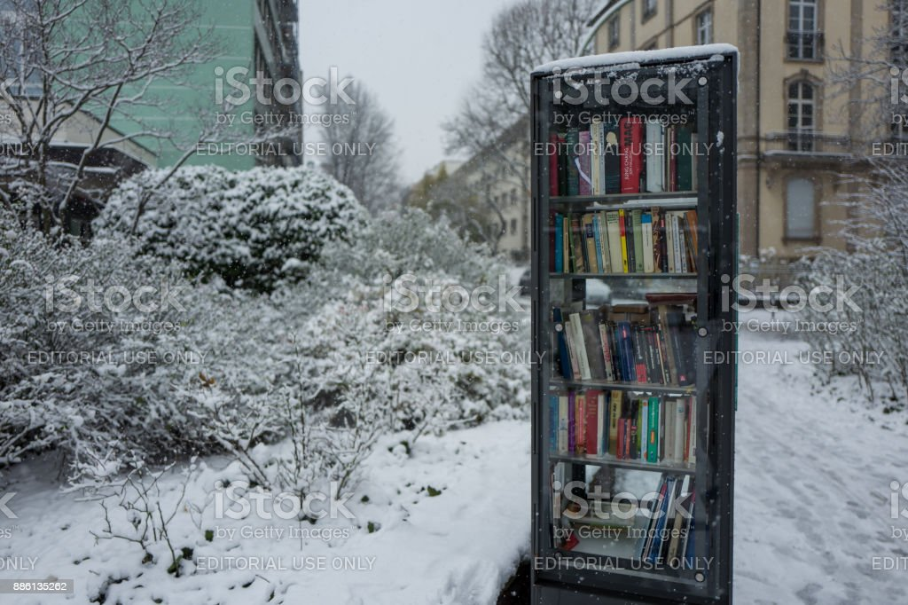 A bookshelf in the snow stock photo