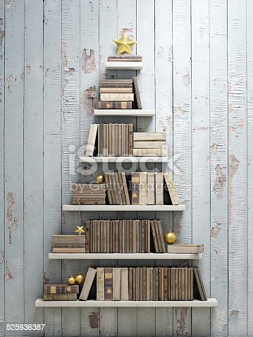1057183432 istock photo bookshelf shaped christmas tree, background 525936387