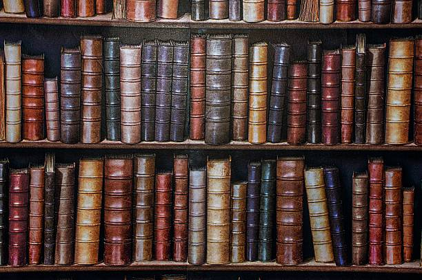 bookshelf wallpaper. - literature stock pictures, royalty-free photos & images