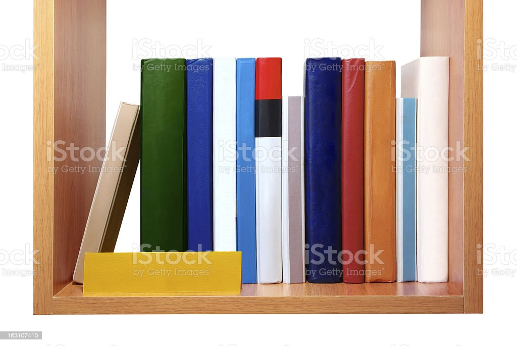 Bookshelf with blank multi colored books royalty-free stock photo