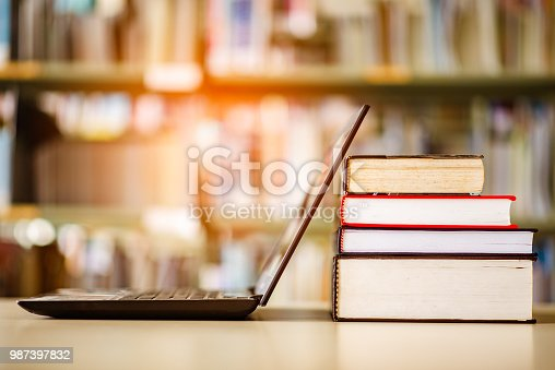 istock Bookshelves and laptops are placed on the library desk. 987397832