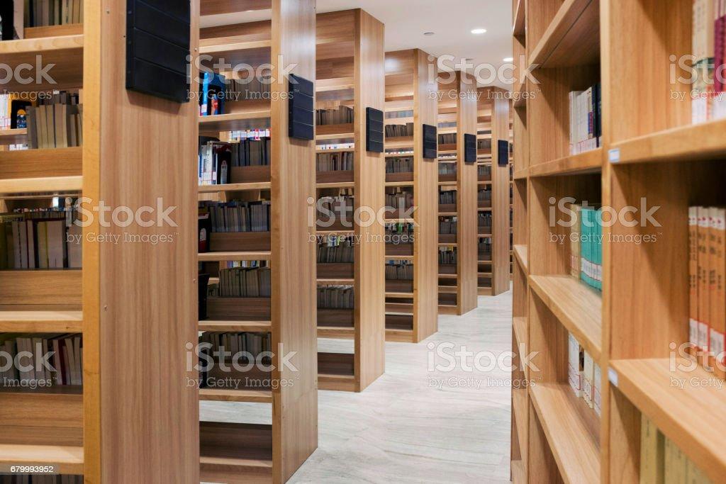Bookshelves in the library stock photo