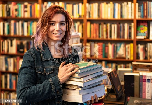 A young woman working at a bookstore in San Francisco, California.