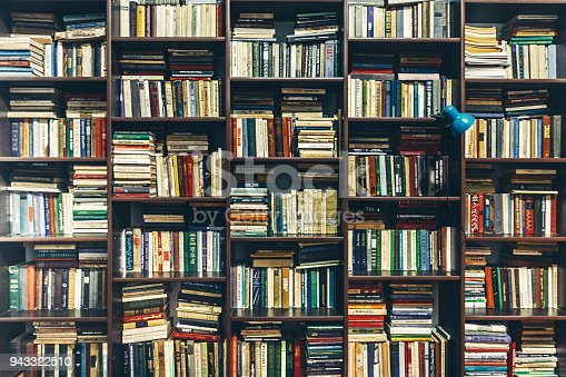 Book shelves in library. Creativity Background Concept