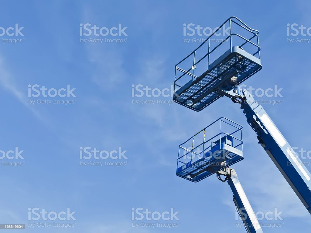Boom lifts with copy space stock photo