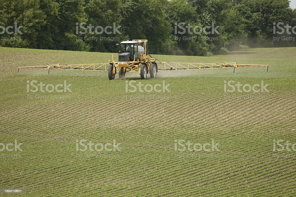 Boom  Sprayer Applying Pesticide to Spring Soybean Field royalty-free stock photo