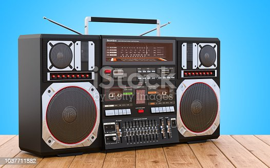 istock Boombox on the wooden table, 3D rendering 1037711882
