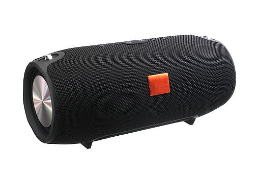 Big black boombox with textile mesh on a white background