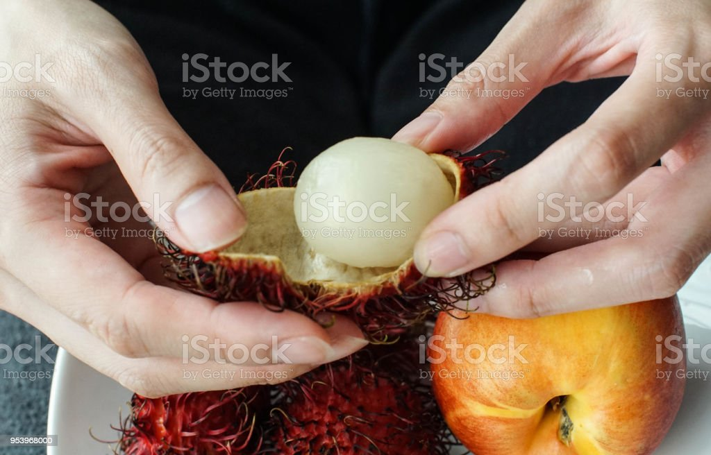 boost energy by eating this exotic Rambutan fruit stock photo