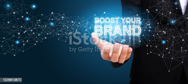 843789992istockphoto Boost Your Brand in the hand of business. Boost Your Brand concept. 1029810872