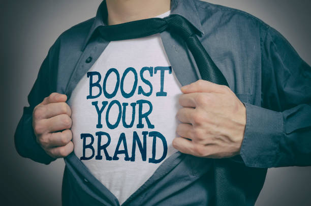 Boost Your Brand Man showing Boost Your Brand tittle on t-shirt adulation stock pictures, royalty-free photos & images