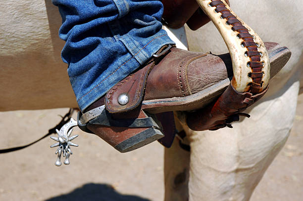 Boot and Spur in Stirrup stock photo