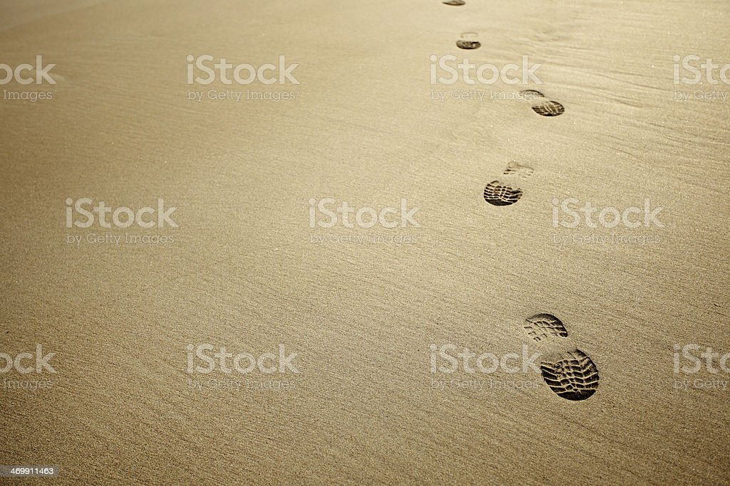 boot prints in Caribbean sand. stock photo