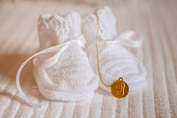 Bootees and a gold chain symbols of a christening of the baby picture id1217794616?b=1&k=6&m=1217794616&s=612x612&w=0&h=334i gew1gp8rcvxqxozt04lvc m9usmvgdxkgziqpg=