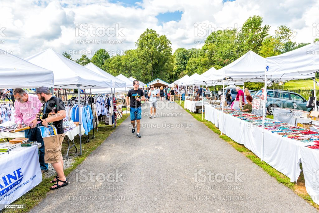 Booths of Ukrainian goods at St. Andrew Ukrainian orthodox cathedral near Washington DC during 15th Ukrainian festival with people stock photo