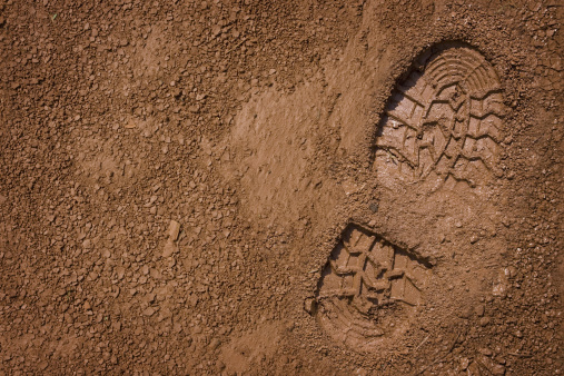 Imprint of the shoe on mud with copy space