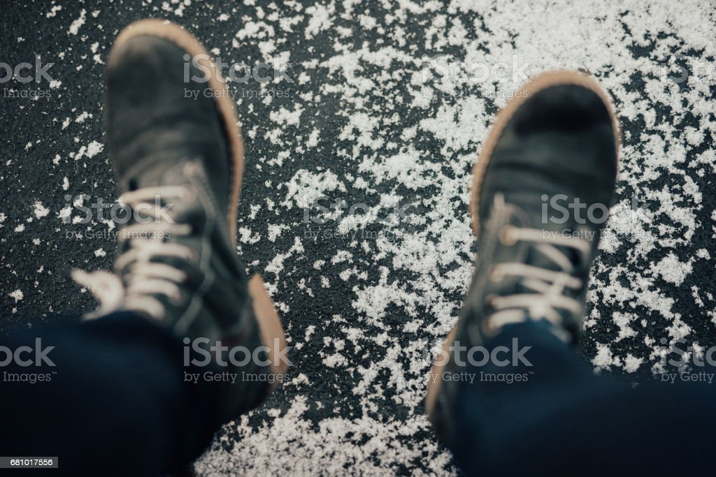 Boots above the frozen lake. Taken from above royalty-free stock photo