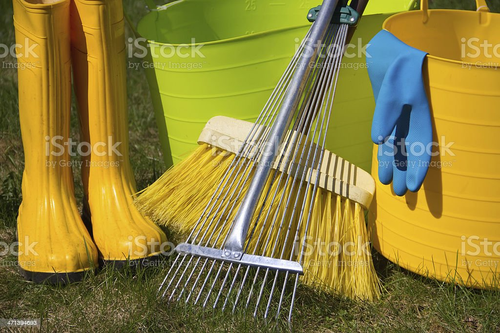 boots and garden tools on grass royalty-free stock photo