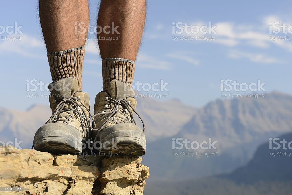 Boots and Legs of Hiker with Mountains in Distance royalty-free stock photo