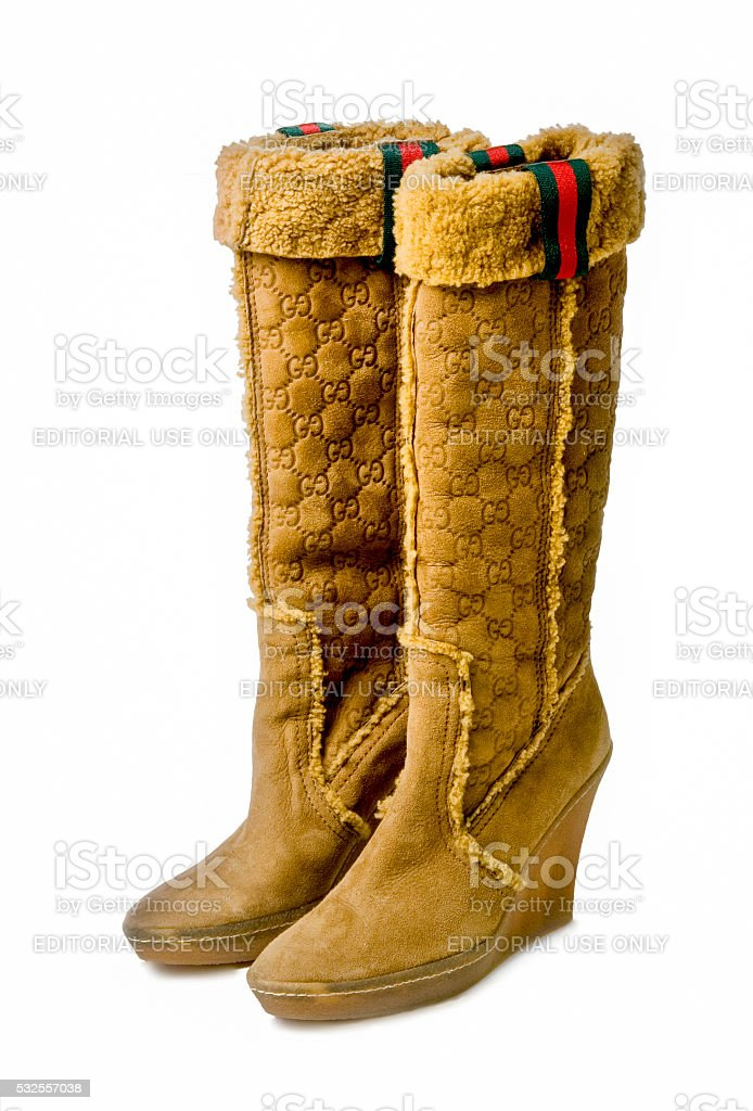 Boots by Gucci on white stock photo