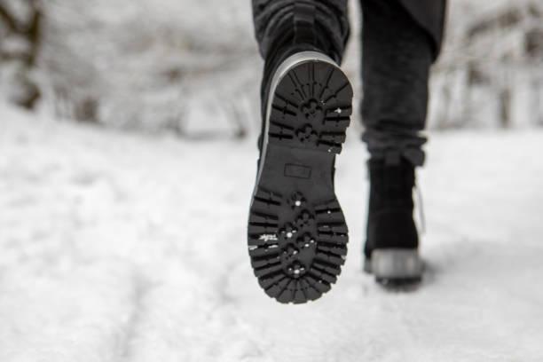 boots footprint close up walking outdoors stock photo