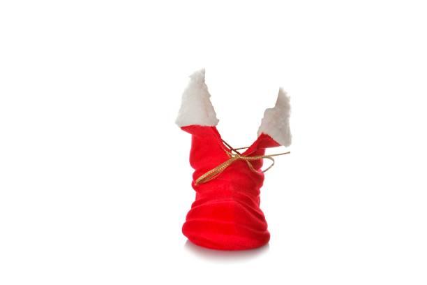 stiefel vom weihnachtsmann - nikolausstiefel stock-fotos und bilder