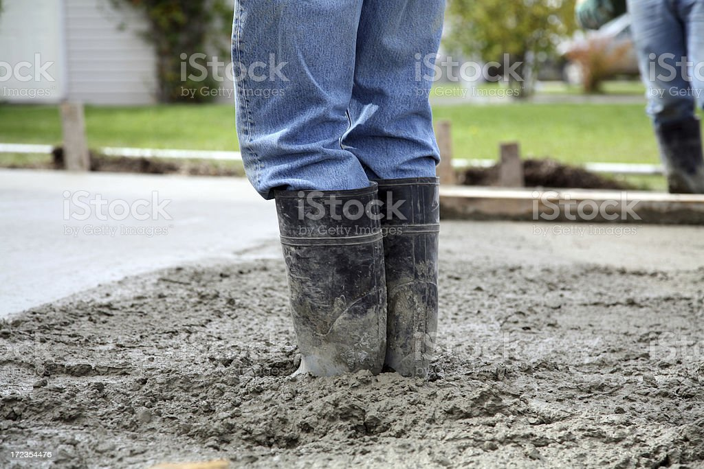 Boots in cement royalty-free stock photo