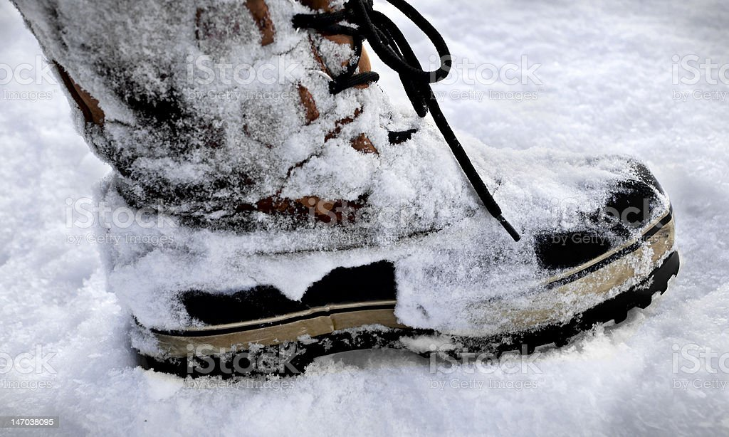 Boots on snow royalty-free stock photo