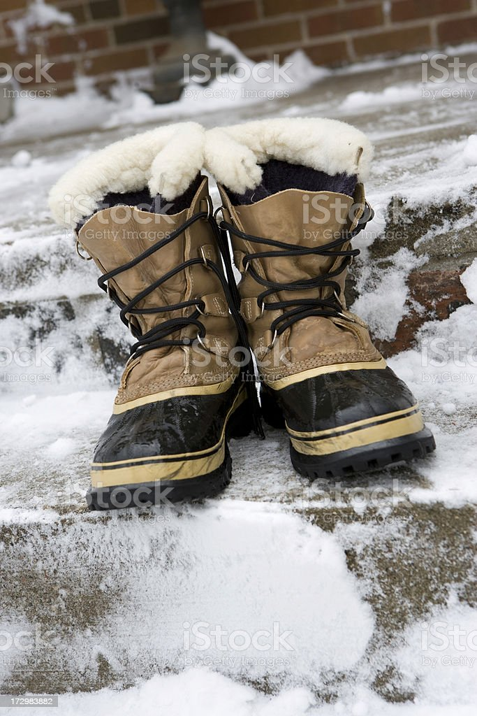 Boots on the steps after shovelling royalty-free stock photo