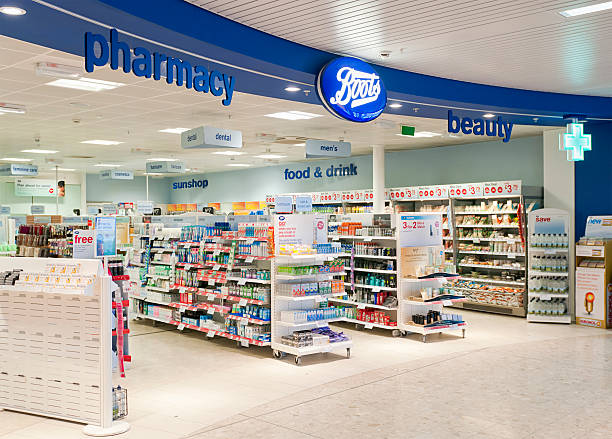 boots shop entrance - chemist stock photos and pictures