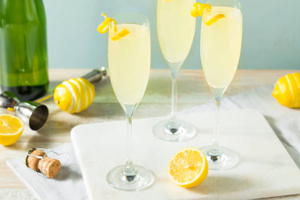 Boozy Bubbly Lemon French 75 Cocktail Boozy Bubbly Lemon French 75 Cocktail with Champagne french culture stock pictures, royalty-free photos & images